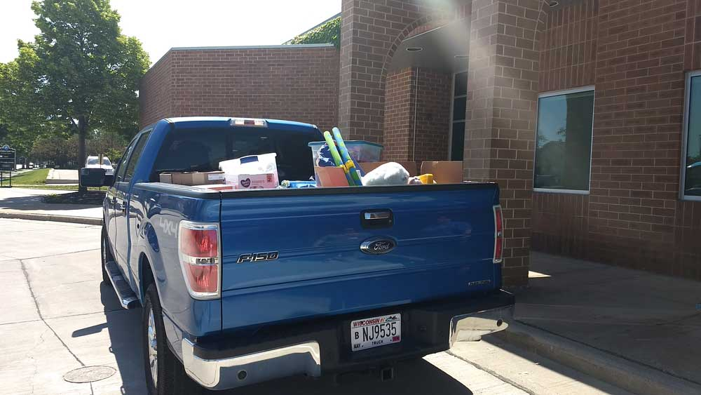 family services truck loaded with layette items